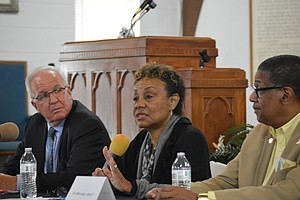 "DCFS Director Beverly ""BJ"" Walker with State Senator Pat McGuire (left) and Will County Board member Herb Brooks (right) answers questions at a public forum held in Joliet on Tuesday.   Walker was in town to address reforms that have been enacted following the death of Joliet toddler Sema'j Crosby in April."