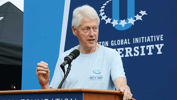 Former President William Clinton visited Madison Park Technical High School during the Clinton Global Initiative Day of Action. The event brought together about 800 CGI U attendees to participate in community volunteer programs.