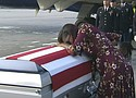 "In this Tuesday, Oct. 17, 2017, frame from video, Myeshia Johnson cries over the casket of her husband, Sgt. La David Johnson, who was killed in an ambush in Niger, upon his body's arrival in Miami. President Donald Trump told the widow that her husband ""knew what he signed up for,"" according to Rep. Frederica Wilson, who said she heard part of the conversation on speakerphone."