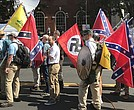 "Alt-right members preparing to enter Emancipation Park holding Nazi, Confederate, and Gadsden ""Don't Tread on Me"" flags in Charlottesville, Va."