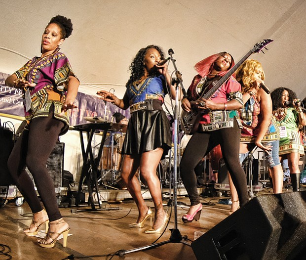 Folk Festival turns up lively music, crowd // Thousands of people enjoyed the festive atmosphere of this year's Folk Festival, which, as always, featured a variety of music genres. Washington D.C.'s Be'la Dona go-go band displays music girl power on stage.