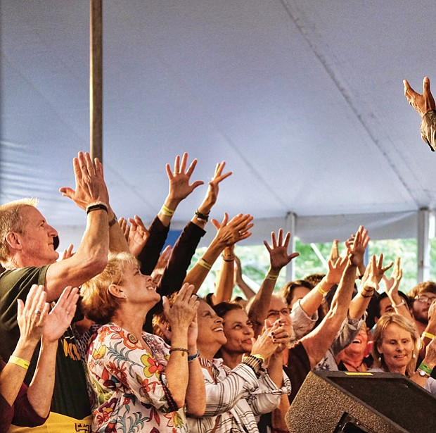 Folk Festival turns up lively music, crowd // Memphis soul singer Don Bryant, bottom right, raises the roof for a cheering crowd.
