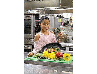 Emmy Sumpter, 11, winner of the Food Network's Chopped Junior cooking contest, shows off her skills in the kitchen at St. Catherine's School in Richmond's West End.