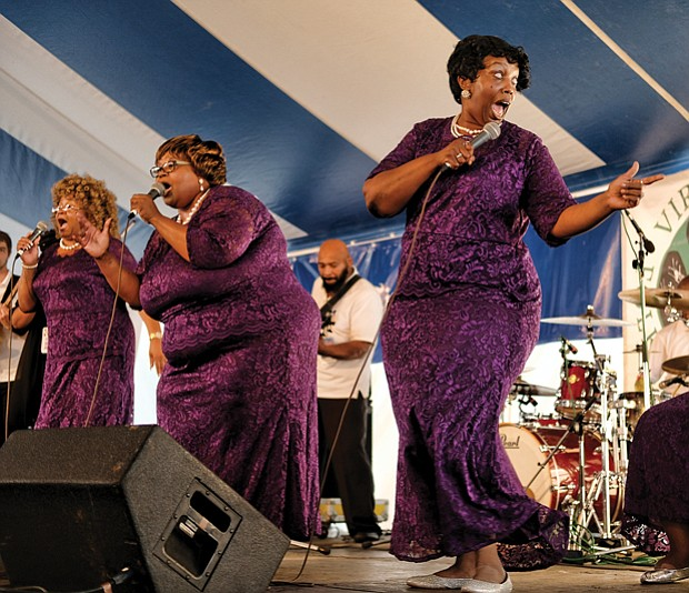 Folk Festival turns up lively music, crowd // The Legendary Ingramettes, below center, rouse the audience and warm the soul with their gospel sounds.
