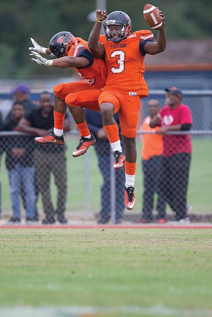 VSU celebrates homecoming //  The real action was on the field where jubilant VSU football players leap, above right, while keeping intact their winning streak. The Trojans beat Bowie State 47-35 before a festive homecoming audience of more than 17,000.