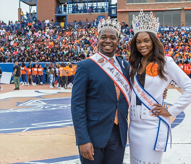 VSU celebrates homecoming // Da'Shunnda-Howard, Miss Virginia State University and Isaac Hargrove, Mr. Virginia State University, above left, strike a pose during VSU's homecoming festivities against Bowie State University at Rogers Field on Saturday,