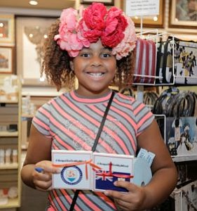 Kayla Young, daughter of Mame, Owner of LaBelle Art Gallery sold raffle tickets at the fundraiser for Caribbean Island of Anguilla.