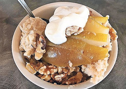 Crème fraîche and poached pears are added to a steel-cut oats recipe from