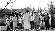 "A neighborhood choir sings during a 1986 Say Brother broadcast titled ""The Nine Voices of Christmas."""