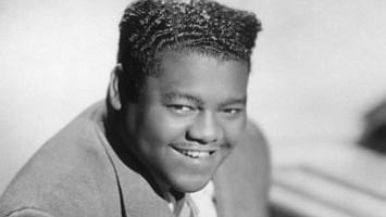 "Antoine ""Fats"" Domino, a titan of early rock 'n' roll whose piano-based hits -- such as ""Ain't That a Shame,"" ..."