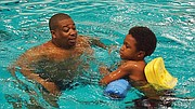Dirk Bovell instructs a student in the Boston Asthma Swim Program.