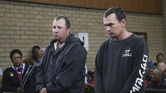 Two white South Africans have been sentenced to more than a...