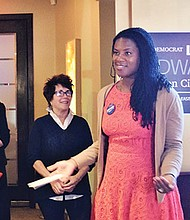 District 1 City Council candidate Lydia Edwards addresses supporters during a fundraiser at The Living Room in the North End.