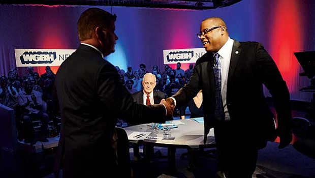 Mayor Martin Walsh and District 7 City Councilor Tito Jackson greet each other prior to the WGBH debate.