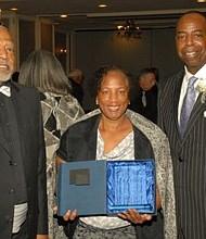 "Janet Stevenson, received the ""Bridge Builder ""award with her husband Bill Stevenson and Pastor, Reverend Dr. Philip J. Ginyard."