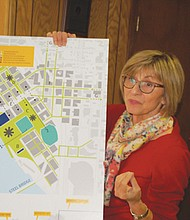 The Albina Vision for the Rose Quarter district is displayed as a fully functioning neighborhood, keeping the sports and entertainment venues, but returning new residential and business-centered blocks.  Zari Santner, a retired Portland Parks Bureau director, is one of the volunteers and advocates behind the grass roots plan.