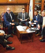 State representatives Byron Rushing, Frank Moran, Chynah Tyler, Jeffrey Sanchez, Carlos Gonzalez, Evandro Carvalho, Jose Tosado, Russell Holmes and Bud Williams in Sanchez's office.
