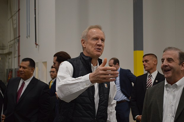 Governor Bruce Rauner meets with officials ahead of the grand opening of a new General Mills distribution center in Wilmington.
