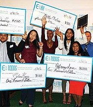 A cohort of EparaTodos entrepreneurs in Lawrence celebrates success and cash awards.