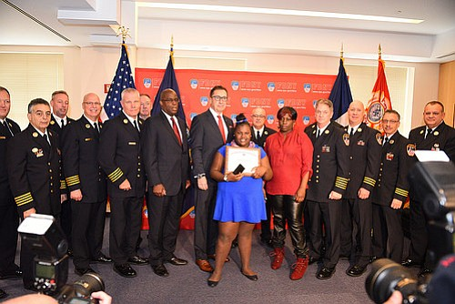 The New York City Fire Department of New York recognized 12-year-old Jamoneisha Merritt as an honorary firefighter Thursday, after she ...