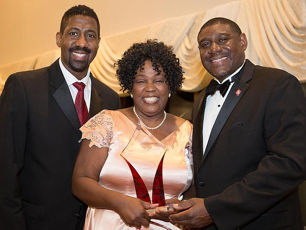 President of Kappa Community Development Corporation, Erik J. Burrell with award recipient and Retired Educator, Minretta Boone McFadden and Burlington-Camden (NJ) Alumni Chapter of Kappa Alpha Psi Fraternity, Inc., Polemarch, Richard Horton, III.