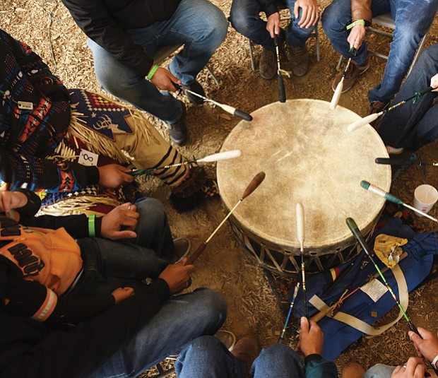 Honoring ancestors and culture// The powwow featured Native American arts and crafts, food and entertainment, including a traditional drum circle, shown below. The two-day event drew people from across the region.