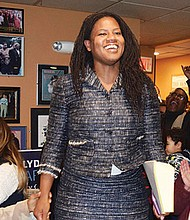 Lydia Edwards celebrates victory with supporters at East Boston restaurant, Kelley Square Pub.
