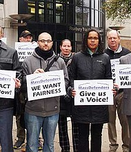 CPCS employees and supporters demonstrate in front of Roxbury District Court.