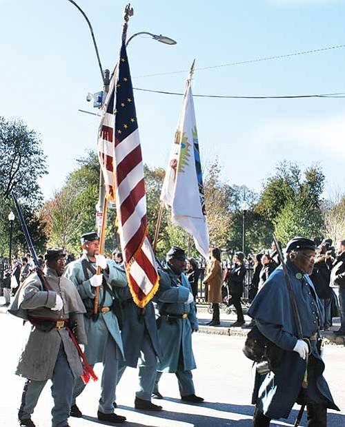 Civil War re-enactors march along Tremont Street in the Veterans Day parade this past Saturday.