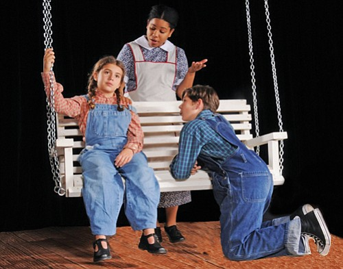 Monica Fleetwood (from left), Kate McLellan  and Bram Allahdadi star in Lakewood Theatre Company's 'To Kill a Mockingbird,' now playing through Dec. 10.