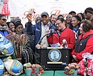 Brooklyn Borough President Eric L. Adams held a paper turkey made by the daughter of Melanie Lavelle, founder of financial literacy mobile application Benefit Kitchen (center-right), as he joined volunteers outside Brooklyn Borough Hall to distribute 15,000 pounds of food, including turkeys and healthy trimmings, to more than 100 local food pantries and houses of worship that are serving Brooklynites in need this Thanksgiving.