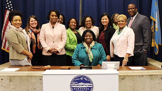 The Psi Omega Chapter (Boston Graduate Chapter) of Alpha Kappa Alpha Sorority, Inc. held AKA Day at City Hall to expose, engage, educate and empower its membership of college-trained professional women to Take A.C.T.I.O.N. in municipal governance. A week after the 2017 municipal election, on Nov. 15, a delegation of Psi Omega Chapter members met with several Boston City Councilors and executive administrators to explore the topics of elections, municipal governance, education, and women's advancement.  (l-r): Psi Omega members Ashley Brown (AKA Day on City Hall Chair), Darlene Hall, DiOnetta Jones Crayton, President Chenita Daughtry (seated), Marilyn Marion, and Alisa Drayton (AKA Day on City Hall Vice Chair). City officials pictured include Megan A. Costello, Executive Director for the Mayor's Office of Women's Advancement, At-Large Boston City Councilor Ayanna Pressley, Chelsey Cartwright, City Councilor Tito Jackson, and At-Large City Councilor and City Council President, Michelle Wu.