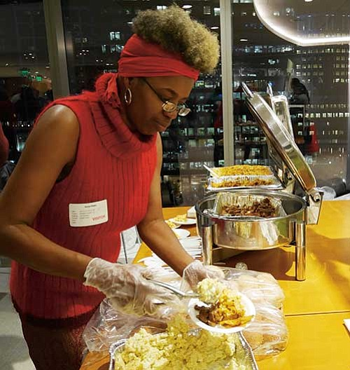 Kenya Madry of Scrumptious Food Truck dishes up a sample plate.