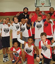 The 5th and 6th grade boys basketball team from the Northeast Blazer's Boys and Girls Club team is led by coaches Jeff Ta (back row, from left), Mark Washington and Chazz Hawkins.