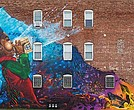 "The ""Breathe Life"" mural at 324 Blue Hill Ave. is by Rob Gibbs, who goes by the artist name Problak."