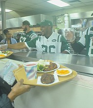 New York Jets players serve food at Food Bank for New York City's Community Kitchen and Food Pantry of West Harlem
