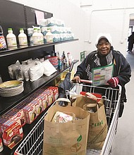 Linda Colbert is thankful to pick up some free groceries and clothes to help her family through difficult times on the opening day for a new permanent food pantry and clothing depot at 12436 S.E Stark St. operated by the Portland Police Bureau's Sunshine Division.