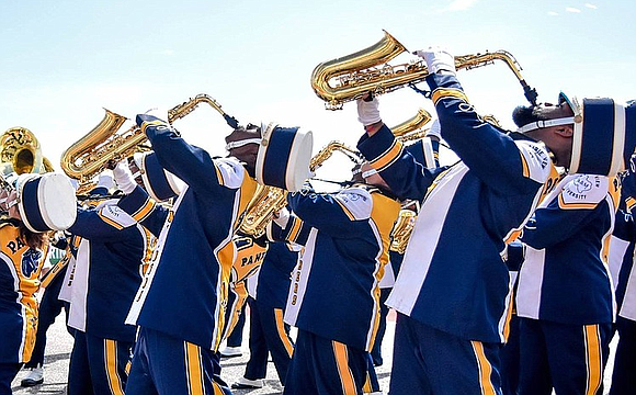 The Prairie View A&M University Marching Storm's head band director Dr. Timmey Zachery talks with the AmNews about the bands' ...