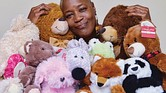 Cynthia Downing is surrounded by some of the stuffed animals she has collected for The Comfort Movement project she started to help Richmond area youngsters whose parents are incarcerated.