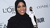 U.S. Olympic fencer Ibtihaj Muhammad shows off the Barbie doll made in her likeness during the 2017 Glamour Women of the Year Awards last week in New York. The doll is scheduled to go on sale next year.