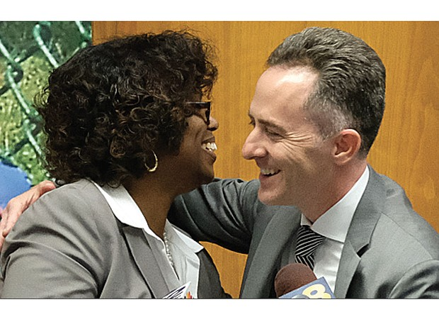 Jason Kamras, the newly selected Richmond Public Schools superintendent, receives a congratulatory hug Monday night from Richmond School Board Chairwoman Dawn Page. Mr. Kamras, who won National Teacher of the Year honors in 2005, is to start Feb. 1.