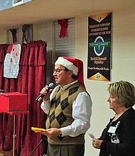 (Pictured left) Thornton Township President Frank M. Zuccarelli and (right) Spirit of Thornton Township Co-chair Shirley Bloodworth addressed the audience at the annual Spirit of Thornton Township. The Spirit of Thornton Township event is the beginning of the Christmas season celebration.