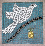 Antiviolence graffiti is replicated in a mosaic.