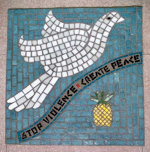Antiviolence graffiti is replicated in a mosaic.