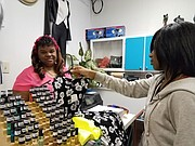 Sandra Moore, owner of Sandy's Unique in Joliet, said that business was slow at her store on Small Business Saturday.