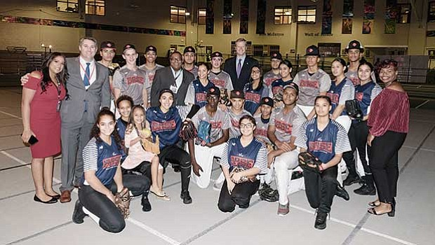 BASE Board Chair John Cook of UBS (2nd from left), with Robert Lewis, Jr. and Governor Baker and Baseball and Softball coaches and players.