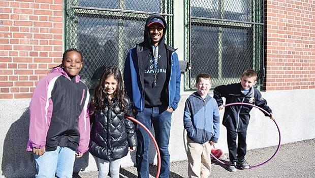 Fidelis Teixeira with his students at the Joyce Kilmer K-8 School.