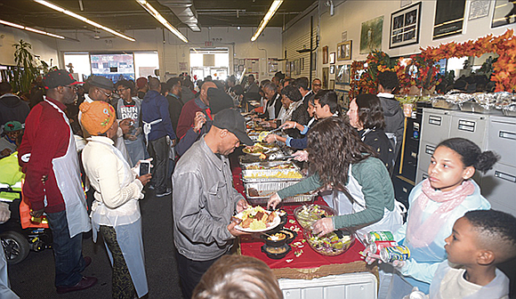 All over the city, New Yorkers spent at least a part of their Thanksgiving Day serving food to fellow New ...
