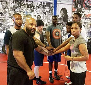 Destiny Day-Owens (far right) At age 22, a former student at the legendary Frederick Douglass High School has overcome a series of setbacks as a youngster and is now ready and prepared to join the nation's elite pugilists, specifically from her Golden Gloves prize rankings to a become a notable professional fighter. Currently, she trains with renowned boxing coach Mack Allison III, (left), owner of the Time 2 Grind gym in Northeast Baltimore. Day-Owens says she always figured the fight game was in her blood.  Photo: Mack Allison III.; Tyrell Boyld; Alexander Teague; Malik Titus; Mack Allison, IV, Tavon Marshall; and Destiny Day-Owens.