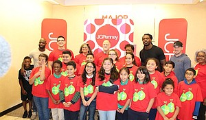 Houston Texans cornerback Johnathan Joseph and defensive end Jadeveon Clowney,  and  Houston Astros third baseman and World Series champion Alex Bregman with the 16 YMCA of Greater Houston excited kids who just got $100 for a JCPenney shopping spree/photo by Reginald Dominique